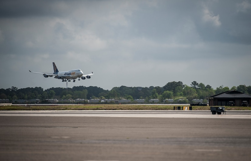 An aircraft carrying the 560th Red Horse Squadron lands at Joint Base Charleston – Air Base, S.C., April 11, 2013, after completing their first six-month deployment to the Southwest Asia region. The group arrived back home to a cheering crowd of family and friends.. (U.S. Air Force photo/ Senior Airman Dennis Sloan)