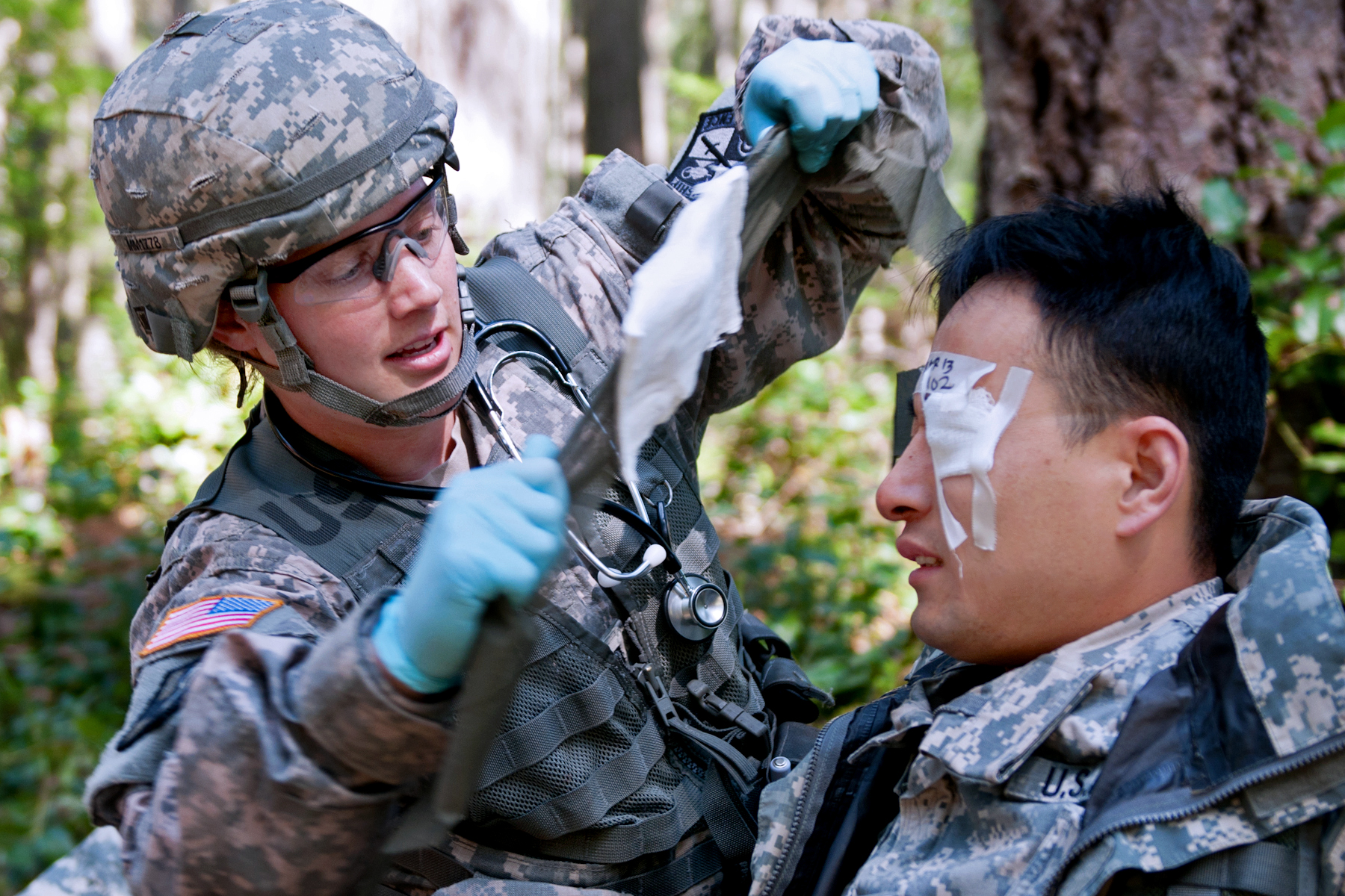Army Capt  Megan Matters, left, treats an eye laceration for