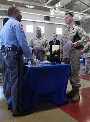 Sgt. Todd Davis, a drill instructor with Service Battalion, and a native of Danville, W.Va., speaks to a representative from the Raleigh Police Department for information on career opportunities with the police department during the 11th Annual Career and Education Fair at the All Weather Training Facility aboard Marine Corps Recruit Depot Parris Island, April 16.