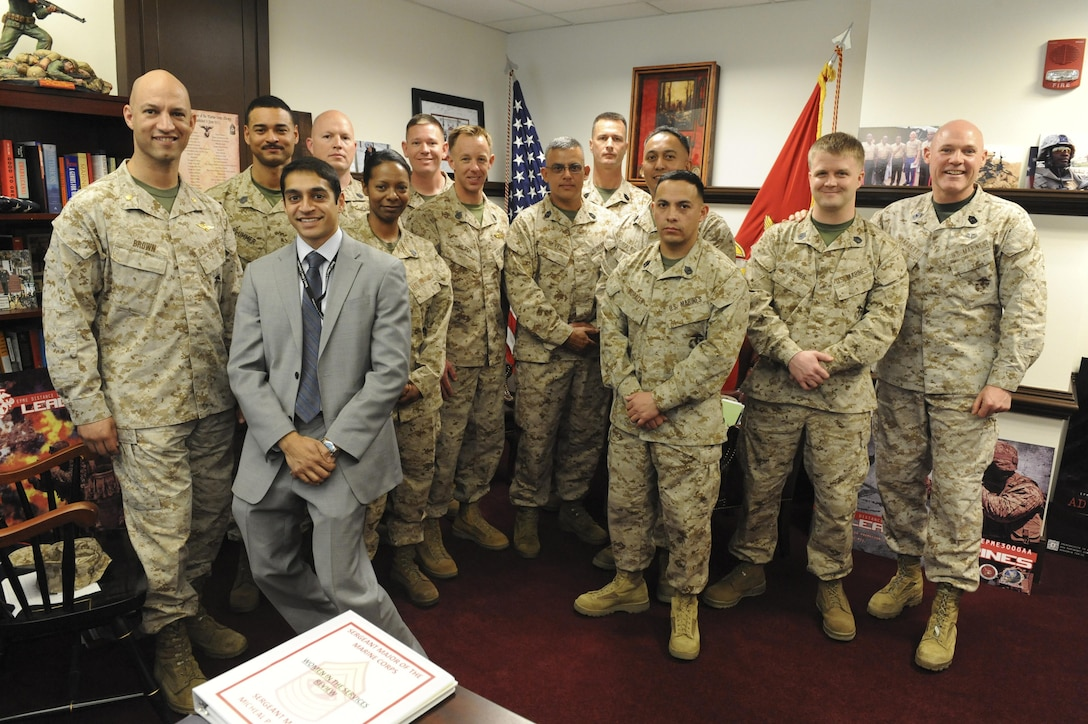 Staff noncommissioned officers selected to participate in the Foreign Area SNCO program pose with Sgt. Maj. Of the Marine Corps Micheal P. Barrett, far right. The Foreign Area SNCO program¹s mission is to identify, Select and educate a corps of international affairs marines for future assignments on tactical, operational and strategic-level Marine Corps staffs, joint and combined staffs and for duty with interagency organizations in order to improve MAGTF plans, operations, and security assistance efforts, with language skills, regional expertise, and culture capability. (US Marine Corps photo courtesy of the Office of the Sergeant Major of the Marine Corps)