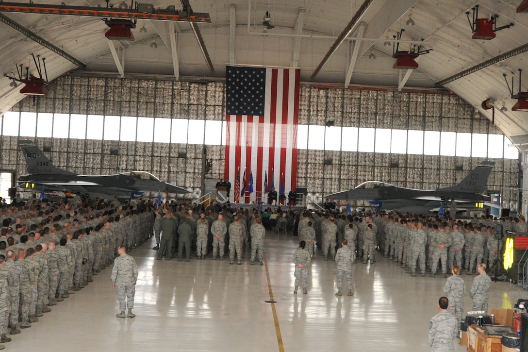 The members of the 140th Wing, Colorado Air National Guard, stand in formation as Brig. Gen. Trulan A. Eyre relinquished command of the wing to Col. Floyd W. Dunstan during a change of command ceremony April 7, 2013 at Buckley Air Force Base. (U.S. Air National Guard photo by Tech. Sgt. Wolfram Stumpf)
