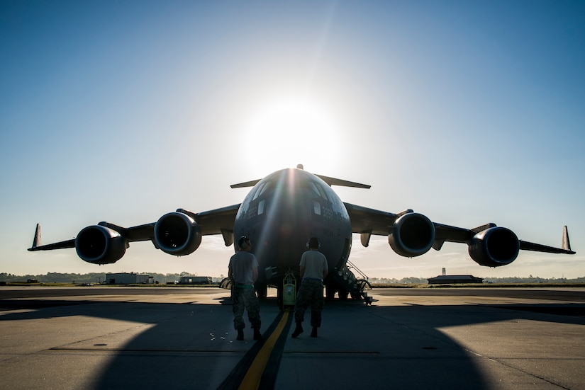 Senior Airman Edward Bachelor (right) and Senior Airman Michael Bowker (left), 437th Aircraft Maintenance Squadron crew chiefs, prepare to perform preflight checks on a C-17 Globemaster III during a training exercise April 10, 2013, at Joint Base Charleston – Air Base, S.C. Thirteen C-17s participated in the exercise which included airdrops, aerial refueling and low-level tactical training. The exercise is a total-force effort with aircrews consisting of active-duty Airmen from the 437th Airlift Wing and 315th AW, and completed over 600 training requirements in a single day. (U.S. Air Force photo/ Senior Airman George Goslin)