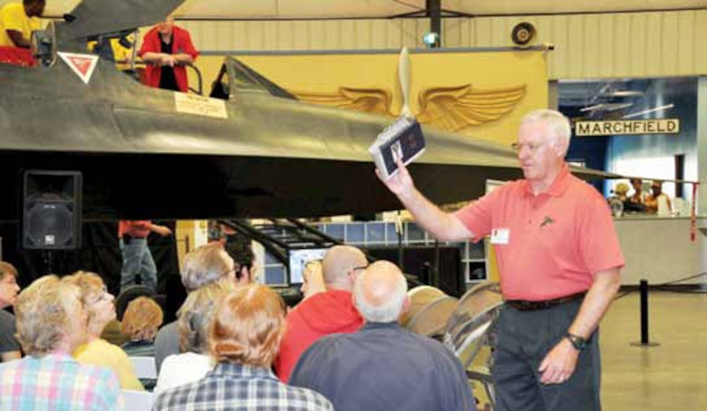 Retired Lt. Col. Gerald Glasser, former SR-71 Blackbird pilot, addresses a crowd of spectators at the March Field Air Museum presentation of the SR-71, the world's fastest aircraft, April 6 and 7. Glasser, along with other former Blackbird pilots delivered a host of memorable events, spoke of little-known facts about the aircraft  and mingled with the visitors. The pilots were on hand for the popular annual two-day event, which continues to draw larger and larger audiences. (U.S. Air Force photo by Staff Sgt. Joe Davidson)
