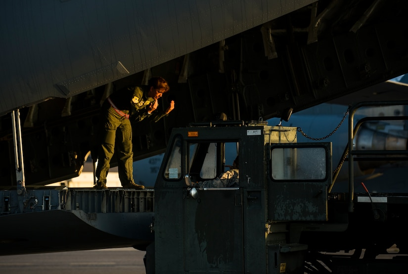 Chief Master Sgt. Jeanette King, 437th Operations Group superintendent, marshals in a k-loader to load cargo during a training exercise April 10, 2013, at Joint Base Charleston – Air Base, S.C. Thirteen C-17s participated in the exercise which included airdrops, aerial refueling and low-level tactical training. The exercise is a total-force effort with aircrews consisting of active-duty Airmen from the 437th Airlift Wing and 315th AW, and completed over 600 training requirements in a single day. (U.S. Air Force photo/ Senior Airman George Goslin)