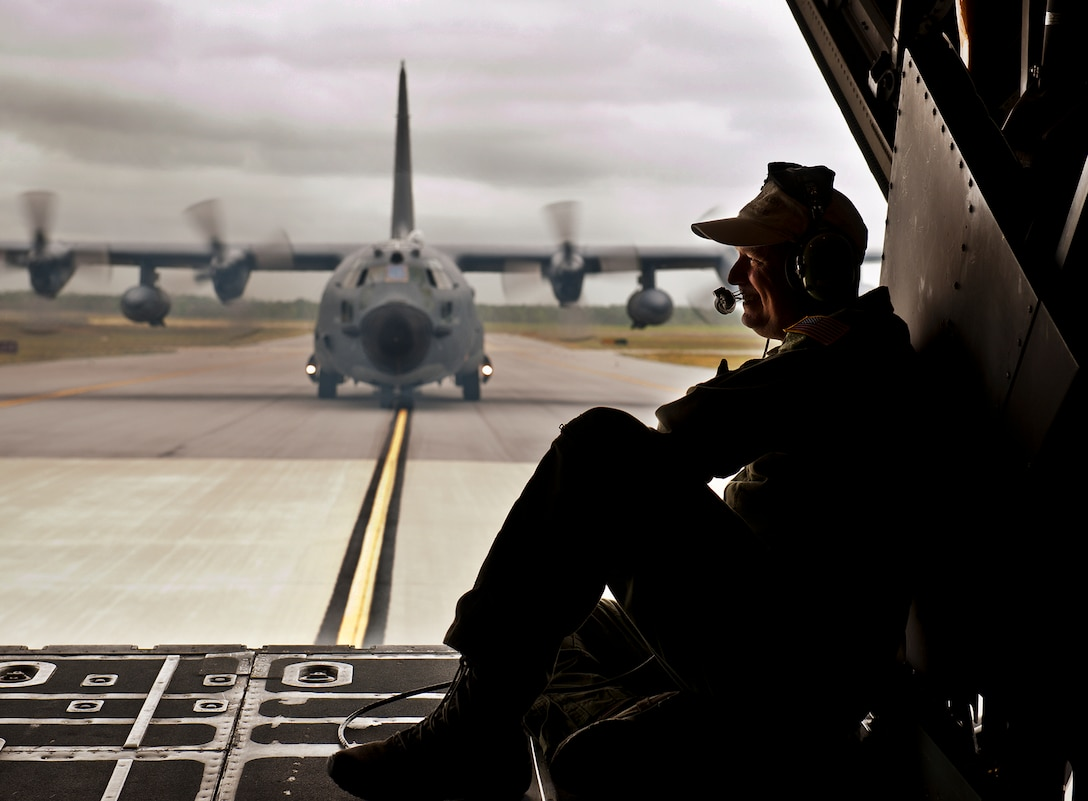 """Chief Master Sgt. Tom Mason, the 919th Special Operations Wing command chief, enjoys his final ride back to base as an MC-130E Combat Talon I loadmaster after completing his and the aircraft's last sortie. The last five Talons in the Air Force belong to the 919th SOW and are scheduled to be retired at a ceremony April 25.  They will make one final flight to the """"boneyard"""" at Davis-Monthan Air Force Base, Ariz., by the end of the fiscal year.  (U.S. Air Force photo/Tech. Sgt. Samuel King Jr.)"""