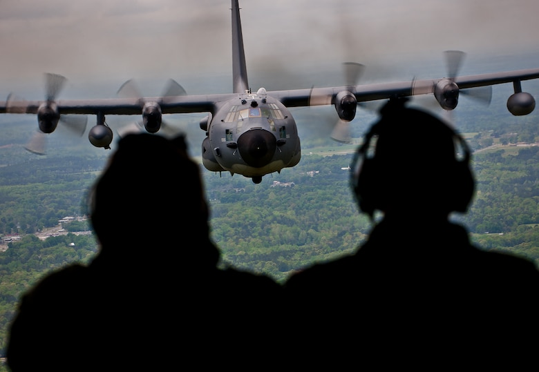 "Aircrew from the 919th Special Operations Wing admire their aircraft, the MC-130E Combat Talon I, in flight one last time April 15 during its final flight before retirement.  The last five Talons in the Air Force belong to the 919th SOW and are scheduled to be retired at a ceremony April 25.  They will make one final flight to the ""boneyard"" at Davis-Monthan Air Force Base, Ariz., by the end of the fiscal year.  (U.S. Air Force photo/Tech. Sgt. Samuel King Jr.)"