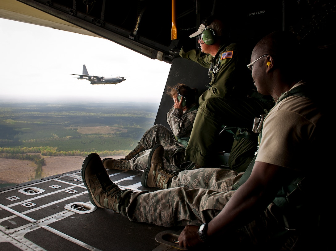 """Members of the 919th Special Operations Wing watch the MC-130E Combat Talon I in flight April 15 during the aircraft's final sortie before retirement. The last five Talons in the Air Force belong to the 919th SOW and are scheduled to be retired at a ceremony April 25.  They will make one final flight to the """"boneyard"""" at Davis-Monthan Air Force Base, Ariz., by the end of the fiscal year.  (U.S. Air Force photo/Tech. Sgt. Samuel King Jr.)"""
