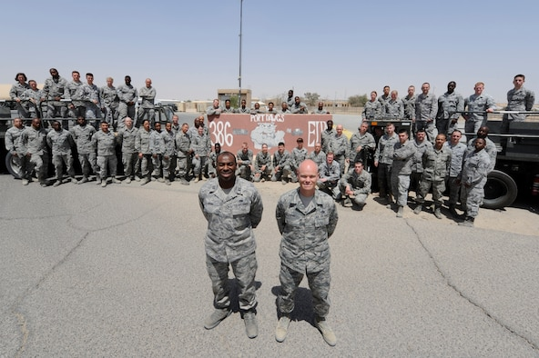 """Senior Master Sgt. Paul Carter, 386th Expeditionary Logistics Readiness Squadron, Port Superintendent (right) with the """"Port Dawgs"""" at the 386th Air Expeditionary Wing, Southwest Asia Apr 15, 2013. Carter is one of 48 Airmen from Dobbins Air Reserve Base, Ga. deployed to 'The Rock' where they make up roughly 60 percent of the 85 member port team. (U.S. Air Force photo by Staff Sgt. Austin Knox)"""