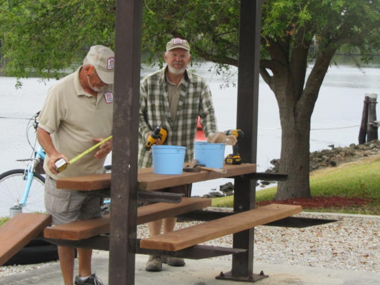 W.P. Franklin Lock volunteers measure twice and cut once when replacing re-planed boards in shelters.