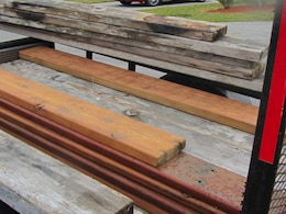 Volunteers re-plane and recycle old boards that are weathered and splintered, making them look like new. The boards are recycled and replaced on picnic tables, benches and other structures, saving both money and resources.