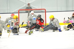 Wounded Warriors playing sled hockey.