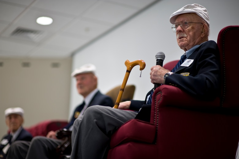 Retired U.S. Air Force Lt. Col. Edward Saylor, one of the Doolittle Raiders, left, makes a point about military service during a session at the 319th Special Operations Squadron auditorium at Hurlburt Field, Fla., April 18, 2013. Dozens of Hurlburt Airmen gathered at the auditorium to listen to Saylor and his fellow Doolittle Raiders on the 71st anniversary of their mission. (U.S. Air Force Photo/Airman 1st Class Hayden K. Hyatt)