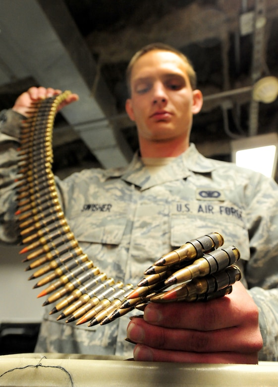 Airman Brandon Swisher, 509th Security Forces Squadron response force member, counts M240 machine gun rounds in the armory during his 12-hour shift at Whiteman Air Force Base, Mo., March 25, 2013.  The armory is a safe and secure location on base to store weapons. (U.S. Air Force photo by Staff Sgt. Nick Wilson/Released)