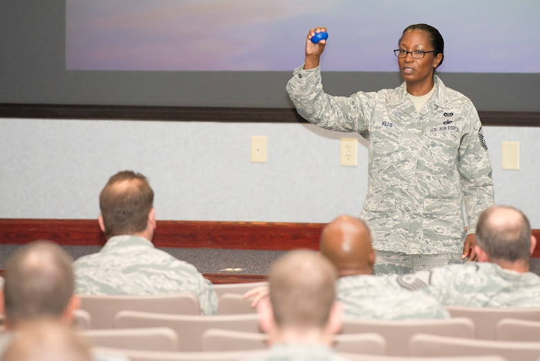 U.S. Air Force Master Sgt. Debra Wills, from the 116th Air Control Wing's Civil Engineering Squadron, uses a rubber ball as a visual aid while sharing her story about resiliency with her fellow Airmen from the 116th ACW, Robins Air Force Base, Ga., April 12, 2013.  The Georgia Air National Guard wing took the day to focus on the resiliency of their Airmen, offering them training and information about the resources available to the Guardsmen and their families.  (U.S. Air National Guard photo by Master Sgt. Roger Parsons/Released)