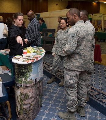 SPANGDAHLEM AIR BASE, Germany -- Stephanie Empain, Explore the Eifel vendor, tells Spangdahlem Airmen April 19, 2013, about unique opportunities in Luxembourg such as hiking. Explore the Eifel is an information fair that provides community members the opportunity to explore recreational activities the surrounding areas have to offer. (U.S. Air Force photo by Senior Airman Natasha Stannard/Released)