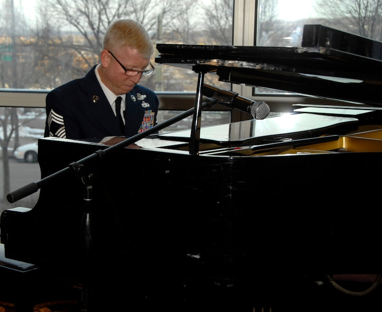 Chief Master Sgt. Dave Coldren, 109th Airlift Squadron, show cases his piano skills for guests at the 133rd Airlift Wing Military Ball, St. Paul, Minn., Apr. 20, 2013. 