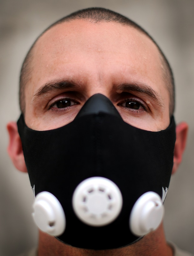 Master Sgt. Robert R. Snyder Jr., Air Forces Central Force Protection liaison officer, wears an elevation training mask, in an effort to improve his cardio and ability to endure higher terrain. Snyder is deployed from Scott Air Force Base, Ill. (U.S. Air Force photo by Technical Sgt. Raymond Hoy)