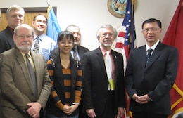 Photo of USACE IWR personnel and visitors from Singapore. Front row (left to right): Mr. Bob Brumbaugh, IWR; Ms. Kee Sanyin, Singapore Housing and Development Board, Infrastructure and Reclamation Department; Mr. Bob Pietrowsky, IWR Director; Mr. Chua Kok Eng, Singapore Housing and Development Board, Infrastructure and Reclamation Department. Back row (left to right): Dr. Joe Manous, IWR; Dr. Hal Cardwell, IWR, Mr. Andy Bruzewicz, USACE Headquarters.