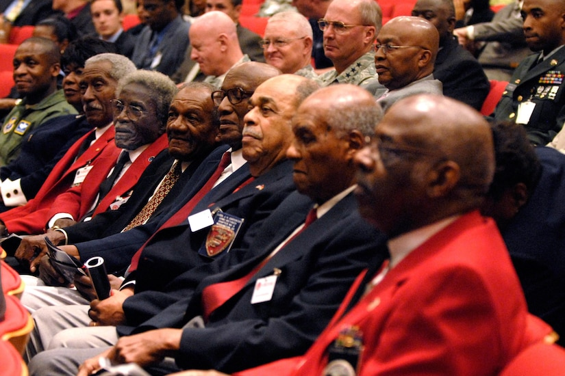 Three Tuskegee Airmen members wearing red jackets, sit among the audience during a ceremony, August 6, 2008 inside the Pentagon Auditorium, hosted by Secretary of Defense Robert M. Gates, not shown, honoring the 60th Anniversary commemorating the signing of Executive Orders 9980 and 9981. The orders were signed in 1948 to desegregrate the armed forces and the federal civil service.