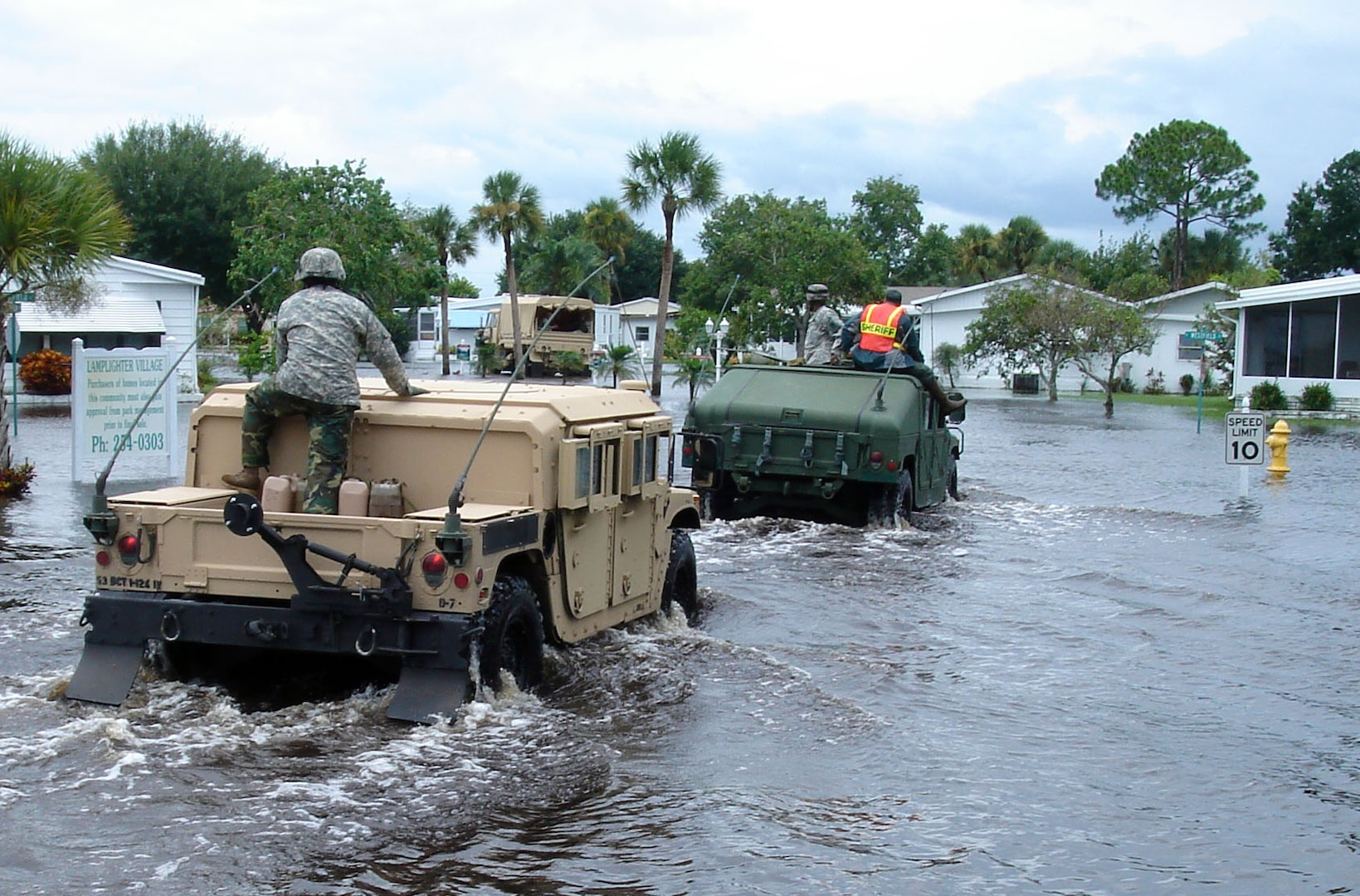 Members of the Florida National Guard's Delta Company, 1st Battalion, 124th Infantry Regiment, enter the Lamplighter Village mobile home park in Melbourne, Fla., to evacuate residents who request it, Aug. 21, 2008. Several residents were transported out of the park over the course of the day.