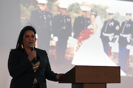 Kristine Schellhaas speaks about the major events, good and bad, that have affected her life as a military spouse during the Live, Laugh and Learn event at the Del Mar Beach Resort here April 19. The Live, Laugh and Learn tour features motivational presentations, book signing and author meet-and-greet events for military wives.