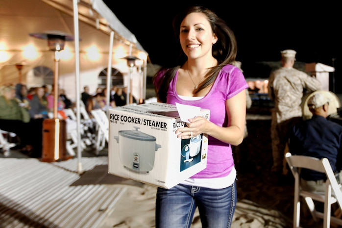 Amber Cousino won a rice cooker during the raffle at the Live, Laugh and Learn event at the Del Mar Beach Resort here April 19. The  tour features motivational presentations, book signing and author meet and greet events for military wives.