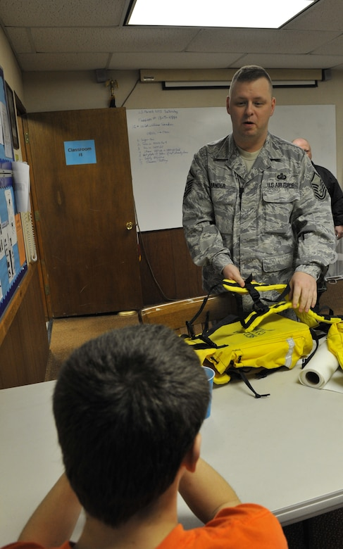 Master Sgt. William Sander, 509th Comptroller Squadron financial services superintendent, explains to a cadet how to assemble search and rescue field gear during a Civil Air Patrol meeting, March 28, 2013, in Sedalia, Mo. Cadets are taught how to use equipment for emergency services missions. (U.S. Air Force photo by Heidi Hunt/Released)