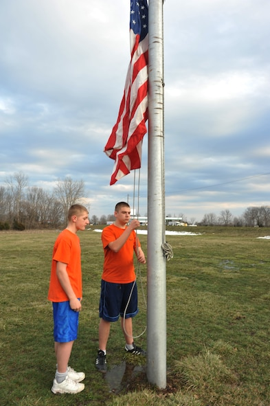 Camren, 15, and Jeremiah, 14, members of the Sedalia Civil Air Patrol squadron, raise the U.S. flag prior to their weekly meeting, March 28, 2013, in Sedalia, Mo. Interested individuals can learn more about opportunities available and membership eligibility during the squadron's weekly Thursday meetings from 6:30-9 p.m. (U.S. Air Force photo by Heidi Hunt/Released)