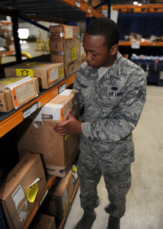 Senior Airman Darryl McCoo, 39th Logistics Readiness Squadron storage and issue journeyman, pulls an item from storage to be picked up by a customer at Incirlik Air Base, Turkey April 18, 2013. The Material Management Flight maintains a large array of supplies for the installation. (U.S. Air Force photo by Senior Airman Chase Hedrick/Released)