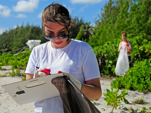 Staff Sgt. Heather Hinton, 36th Wing command post emergency actions controller, notes the types of the trash her group collected during the Earth Day cleanup on Tarague Beach at Andersen Air Force Base, Guam, April 21, 2013. Earth Day is an international event demonstrating the commitment and significant investment the United States and countries have made toward environmental security. (U.S. Air Force photo by Airman 1st Class Marianique Santos/Released)