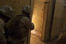 Company B, 2nd Reconnaissance Battalion Marines throw a flash grenade into a room as they clear a training facility during live-fire training at Marine Corps Base Camp Lejeune, N.C., April 19, 2013. More than 120 Marines completed the two-week training, which included close-quarters tactics and flash bang procedures. (Marine Corps photo by Sgt. Austin Hazard/Released)