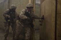 Company B, 2nd Reconnaissance Battalion Marines enter a room as they clear a training facility during live-fire training at Marine Corps Base Camp Lejeune, N.C., April 19, 2013. More than 120 Marines completed the two-week training, which included close-quarters tactics and flash bang procedures. (Marine Corps photo by Sgt. Austin Hazard/Released)