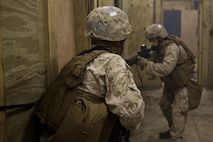 Company B, 2nd Reconnaissance Battalion Marines prepare to enter a room as they clear a training facility during live-fire training at Marine Corps Base Camp Lejeune, N.C., April 19, 2013. More than 120 Marines completed the two-week training, which included close-quarters tactics and flash bang procedures. (Marine Corps photo by Sgt. Austin Hazard/Released)