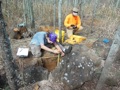 Archaeologists in the field carefully record the rock features that are the former house sites and agricultural fields of Hawaiians that once lived on Mokapu Peninsula.