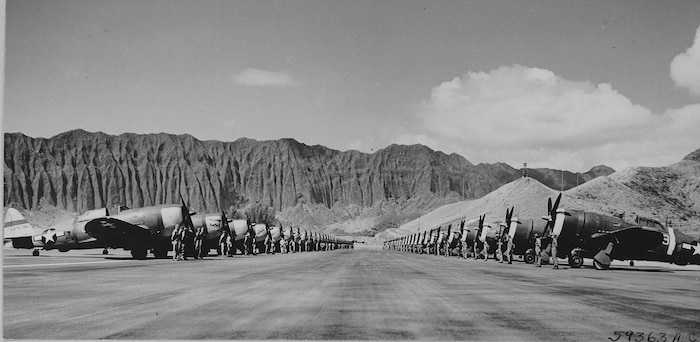 Republic P-47 Thunderbolts lined up for inspection at Bellows Field (now Marine Corps Training Area Bellows) during World War II. The P-47 was the largest fighter aircraft powered by a single-piston engine.  It was heavily armed with eight .50-caliber machine guns and up to 2,500 lbs of Bombs.