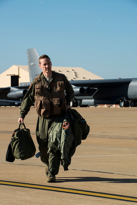 U.S. Air Force Capt. Chris Robinson, 343rd Bomb Squadron pilot, prepares to board a 2nd Bomb Wing B-52H Stratofortress at Barksdale Air Force Base, La., in support of a nuclear exercise at Minot AFB, N.D., April 19, 2013. The 343rd BS is the only nuclear certified squadron in the Air Force Reserve and this will be their first time to participate in a nuclear exercise. (U.S. Air Force photo by Master Sgt. Greg Steele/Released)