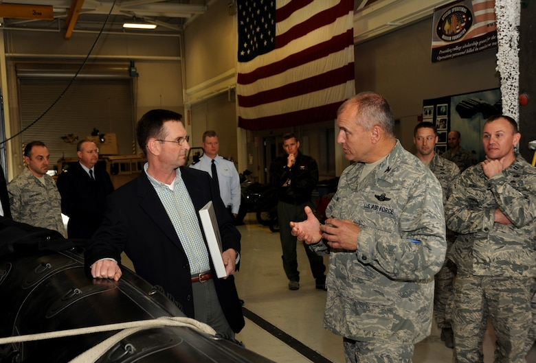 Air Force Col. Michael Bieniewicz, Commander of the Combat Operations Group for the Oregon Air National Guard, describes to Lt. Gen. Joseph L. Lengyel, Vice Chief, National Guard Bureau, some of the equipment used in missions by the 125th Special Tactic Squadron, during a tour of the Portland Air National Guard Base, Portland, Ore., April 18, 2013. (Air National Guard photo by Air Force Tech. Sgt. John Hughel, 142nd Public Affairs)