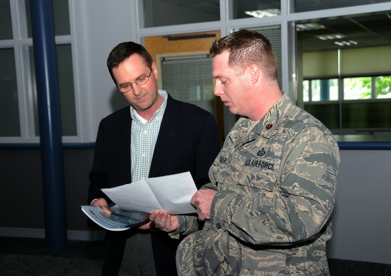 Air Force Maj. Brian Kroeller (right), 142nd Fighter Wing, briefs a new joint training site proposal to Lt. Gen. Joseph L. Lengyel (left), Vice Chief, National Guard Bureau, during his visit to the Portland Air National Guard Base, Portland, Ore., April 18, 2013. (Air National Guard photo by Air Force Tech. Sgt. John Hughel, 142nd Public Affairs)