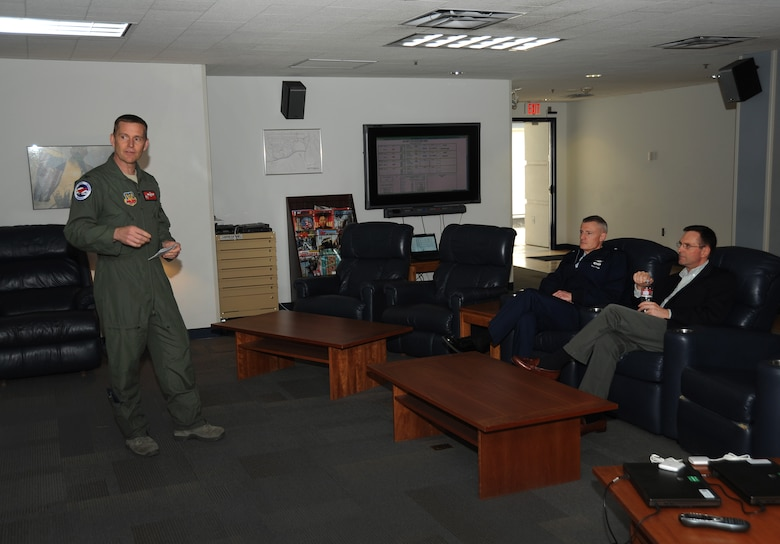 Air Force Col. Rick Wedan, 142nd Fighter Wing Commander gives a briefing to Brig. Gen. Steven Gregg, Commander of the Oregon Air National Guard and Lt. Gen. Joseph L. Lengyel, Vice Chief, National Guard Bureau, during his visit to the Portland Air National Guard Base, Portland, Ore., April 18, 2013. (Air National Guard photo by Air Force Tech. Sgt. John Hughel, 142nd Public Affairs Office)