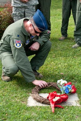 "Lt.Col.Trent Mitchell lays a wreath during a ceremony honoring Captain Thomas ""Pete"" Ray who was shot down during the Bay of Pigs invasion. (U.S. Air National Guard photo by MSgt Ken Johnson/Released)"
