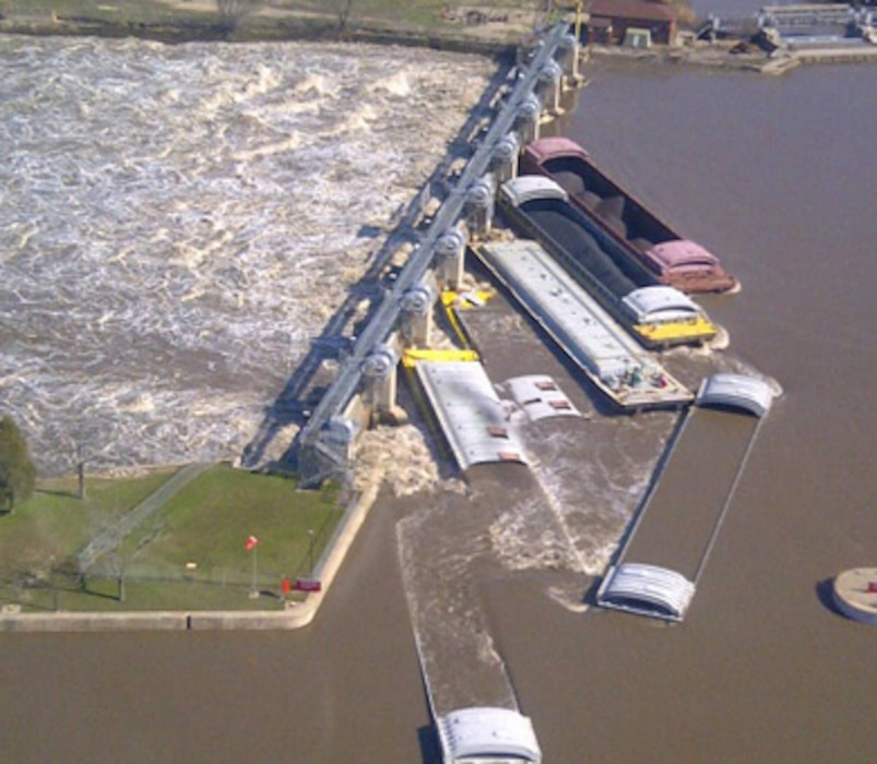 April 22, 2013 - Seven barges rest against Marseilles Dam, Marseilles, Ill., after motor vessel Dale A. Heller lost control of its tow on April 18 due to strong river currents from heavy rainfall. The Coast Guard reported no injuries, pollution or breaches in the dam or nearby levees. The Corps assessed the extensive structural damage to the gates and found the dam to be sound and there are no public safety concerns.