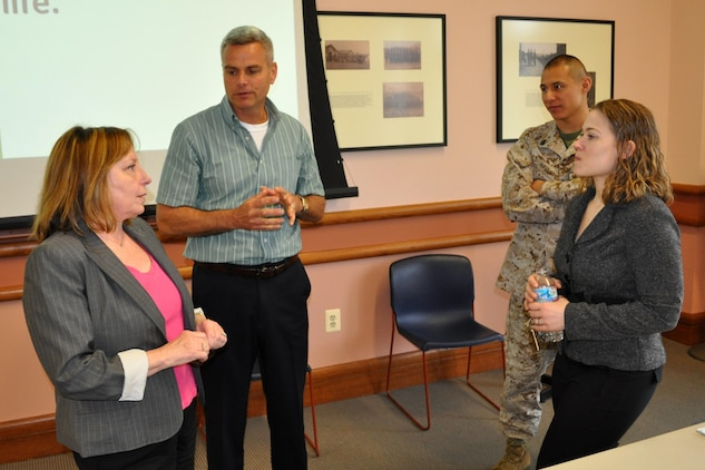 Cindy Davis (left), Marine Corps Foreign Disclosure program manager, speaks to Mike Ansley, Marine Corps Systems Command's Foreign Disclosure team lead, and Staff Sgt. Antonio Navarro and Christina Balocki of the Director of Marine Corps Intelligence at Headquarters Marine Corps, during the 2013 Marine Corps Foreign Disclosure Working Group meeting. MCSC hosted the annual gathering for foreign disclosure officers and personnel who work foreign disclosure issues. The event took place April 16-18 at the Gray Research Center, Quantico, Va.