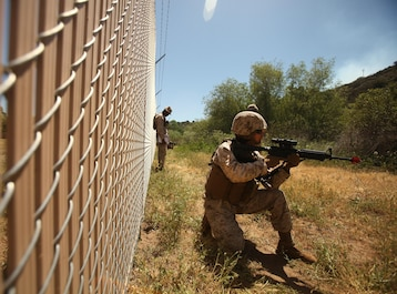 A Marine with 1st Maintenance Battalion, 1st Marine Logistics Group, holds security while on a patrol during the Basic Combat Skills Course aboard Camp Pendleton, Calif., April 18, 2013. Approximately 40 Marines participated in the course designed to refresh Marines in the basics of Marine Corps combat skills to keep them ready for battle.