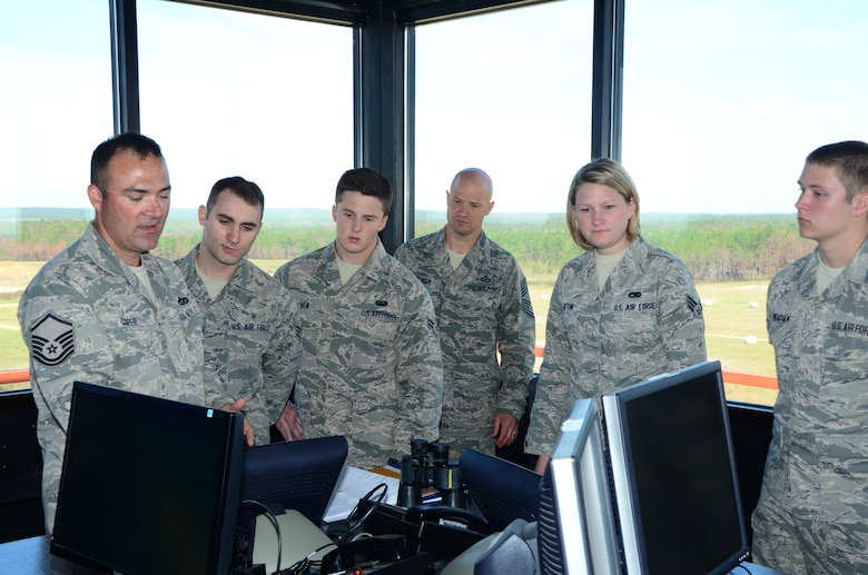 A group of Miss. Air National Guardsmen receive instruction at Camp Shelby's Air to Ground Range control tower during the first-term Airmen retreat that took place on 6 April 2013.  The goal of the retreat was to give the junior Airmen the opportuity to see additional MSANG assets performing their mission and to allow them to gain career insight from senior enlisted personnel.