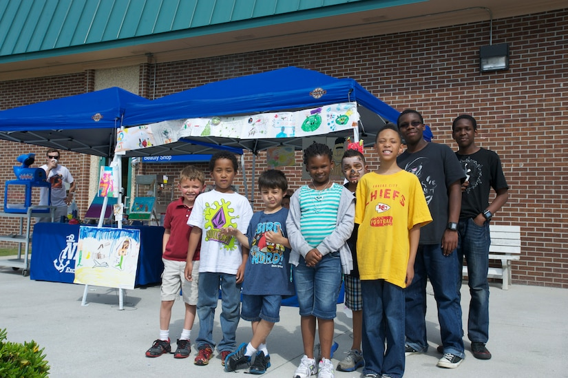 Children from the Joint Base Charleston – Weapons Station Child Development Center enjoy some time in the sun  while displaying their artwork at the Children's Art Gala, April 17, 2013, at JB Charleston – Weapons Station, S.C. The event was to encourage, inspire and promote the creative arts of the children at the Child Development Center at JB Charleston – WS. (U.S. Air Force photo / Airman 1st Class Tom Brading)
