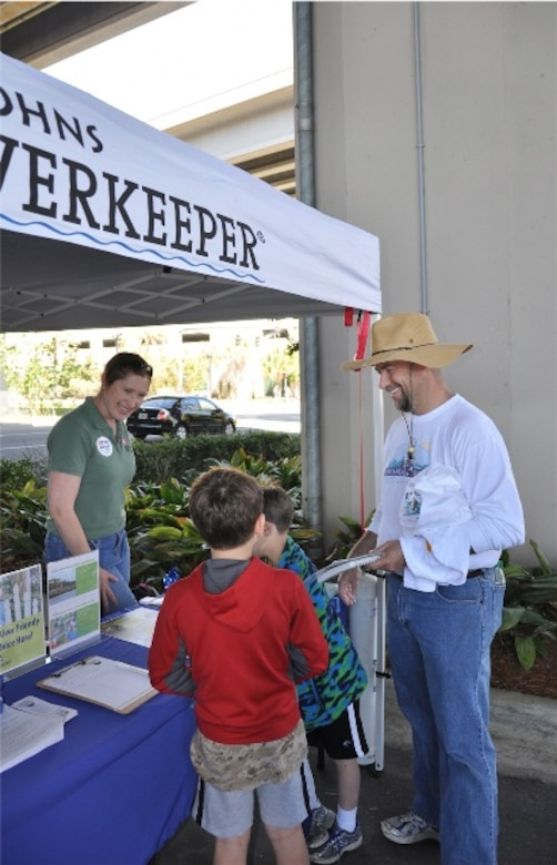 After volunteering for the St. Johns River Cleanup in Jacksonville, Fla. March 16, community members stopped by the Riverside Arts Market, where biologist Jessica Spencer (left) provided information about invasive species located in Florida.