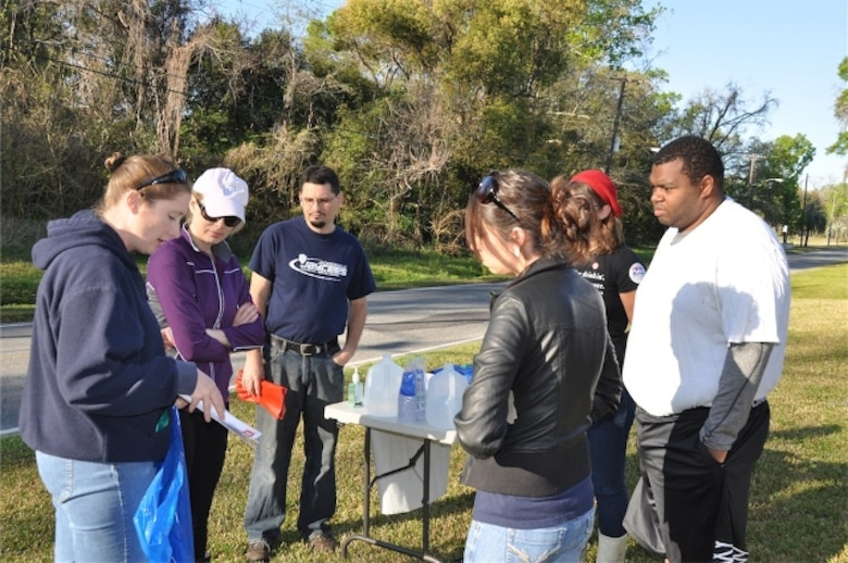 Biologist Jessica Spencer (left) educates a volunteer group about air potato, an invasive vine that has been found at local creek cleanups. The volunteers were at one of many cleanup sites around Jacksonville, Fla. as part of the 18th Annual St. Johns River Cleanup March 16.