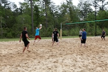 A Marine from Headquarters and Headquarters Squadron serves a volleyball during a game at the Commander's Cup volleyball game, April 19.