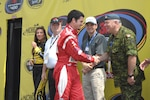 Quebec-native NASCAR driver Patrick Carpentier is warmly greeted by Lt. Gen. Charlie Bouchard, the NORAD Deputy Commander, during the opening ceremonies at the Michigan International Speedway (MIS). Lt. Gen. Bouchard was at MIS as a guest of the speedway during NORAD 50th Anniversary celebrations. Photo by Canadian Forces Lt. Desmond James