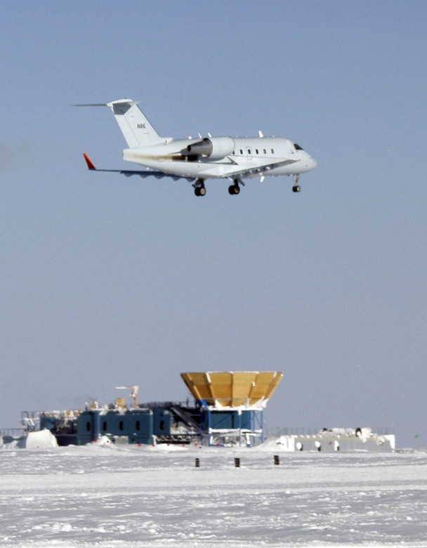 A Bombardier Challenger flown by a 1st Aviation Standards Flight crew, flies over McMurdo Station, Antarctica. The 1st ASF is a small team of reservists that are the only team in the world qualified to inspect McMurdo Station. (Courtesy Photo)
